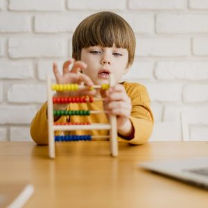 front-view-child-with-abacus-desk_23-2148524670
